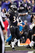 Baltimore Ravens running back Alex Collins (34) celebrates after running for a 7 yard touchdown good for a 7-0 first quarter Ravens lead during the NFL week 11 regular season football game against the Cincinnati Bengals on Sunday, Nov. 18, 2018 in Baltimore. The Ravens won the game 24-21. (©Paul Anthony Spinelli)