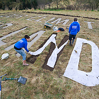 Sipson Jan 15  Greenpeace campaigners cut the words Our Climate Our Land into the area of land that has been purchased by a group [protesting against the proposed thirs runway at Heathrorw Airport...Please telephone : +44 (0)845 0506211 for usage fees .***Licence Fee's Apply To All Image Use***.IMMEDIATE CONFIRMATION OF USAGE REQUIRED.*Unbylined uses will incur an additional discretionary fee!*.XianPix Pictures  Agency  tel +44 (0) 845 050 6211 e-mail sales@xianpix.com www.xianpix.com