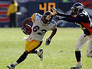 DENVER - JANUARY 22:  Wide receiver Antwaan Randle El #82 of the Pittsburgh Steelers catches a pass and tries to dodge a tackle by Domonique Foxworth #22 of the Denver Broncos in the AFC championship game on January 22, 2006 at INVESCO Field at Mile High in Denver, Colorado. The Steelers defeated the Broncos 34-17. ©Paul Anthony Spinelli *** Local Caption *** Antwaan Randle El;Domonique Foxworth