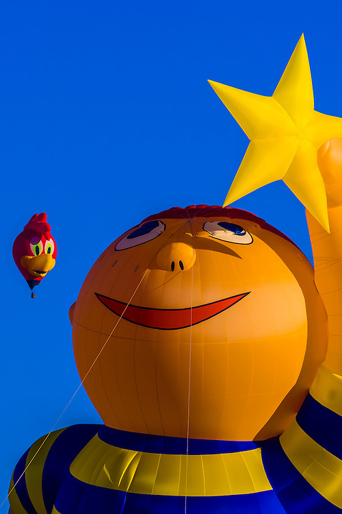 """""""Reach for the Stars"""", a 130 ft. tall special shape balloon (which provides flights and tethered rides to people with special needs). It is meant to encourage people, regardless of the challenges in life, to always Reach for the Stars!, Albuquerque International Balloon Fiesta, Albuquerque, New Mexico USA."""