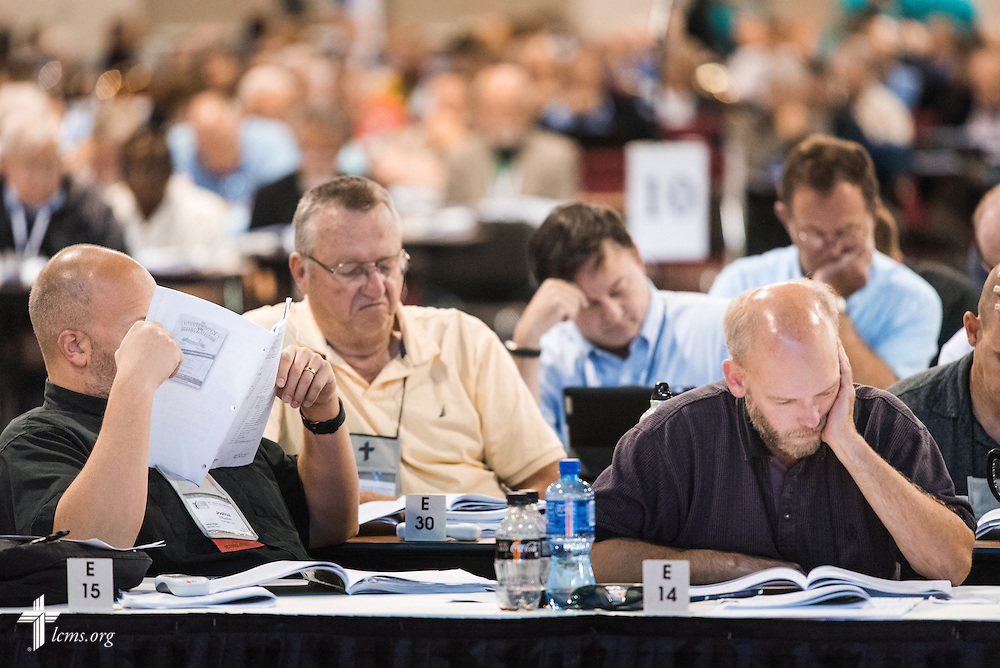 Delegates read through Resolution 12-01A from Floor Committee 12 on Monday, July 11, 2016, at the 66th Regular Convention of The Lutheran Church–Missouri Synod, in Milwaukee. LCMS/Michael Schuermann