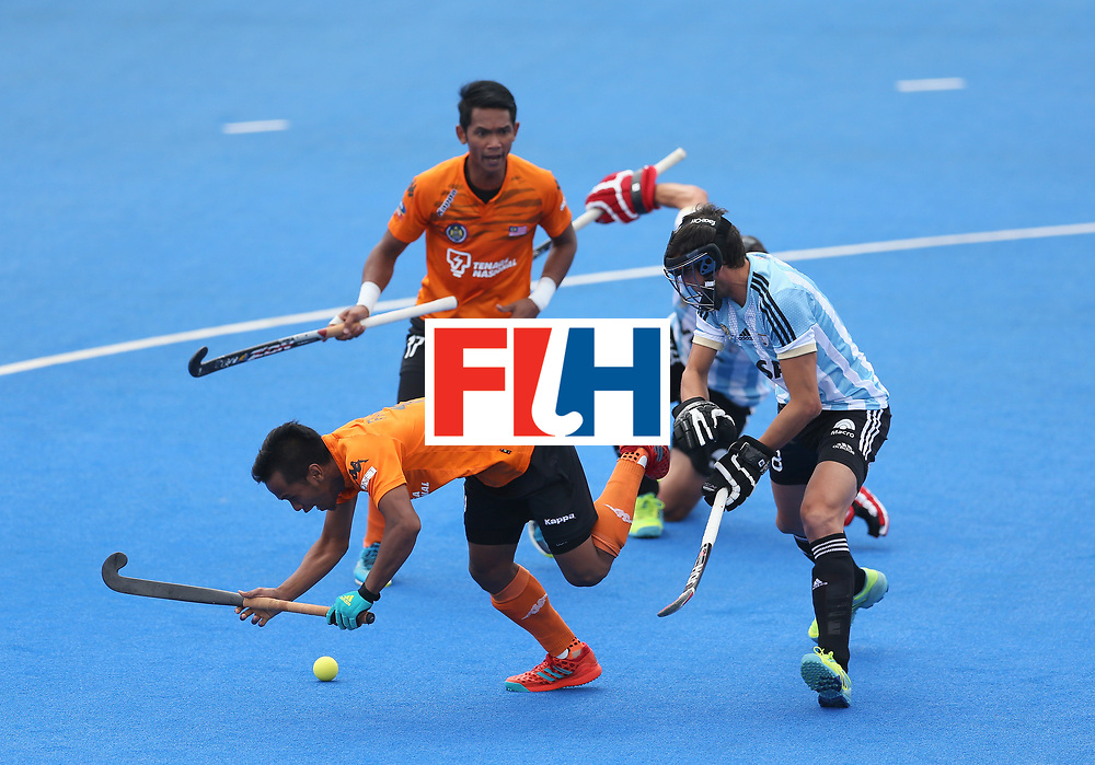 LONDON, ENGLAND - JUNE 24: Faizal Saari of Malaysia is fouled by Lucas Rey of Argentina leading to a penalty during the semi-final match between Argentina and Malaysia on day eight of the Hero Hockey World League Semi-Final at Lee Valley Hockey and Tennis Centre on June 24, 2017 in London, England. (Photo by Steve Bardens/Getty Images)