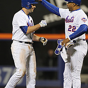 NEW YORK, NEW YORK - APRIL 29:  Neil Walker, (left), #20 of the New York Mets is congratulated by first base coach Tom Goodwin #22 after hitting a run scoring double in the Mets twelve run third inning during the New York Mets Vs San Francisco Giants MLB regular season game at Citi Field on April 29, 2016 in New York City. (Photo by Tim Clayton/Corbis via Getty Images)