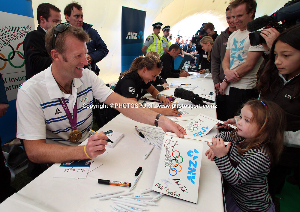Mahé Drysdale signs autographs for members of the public. ANZ New Zealand Olympic team welcome home event at Pioneer Recreation and Sport Centre, Christchurch, Friday 24 August 2012. Photo : Joseph Johnson/photosport.co.nz