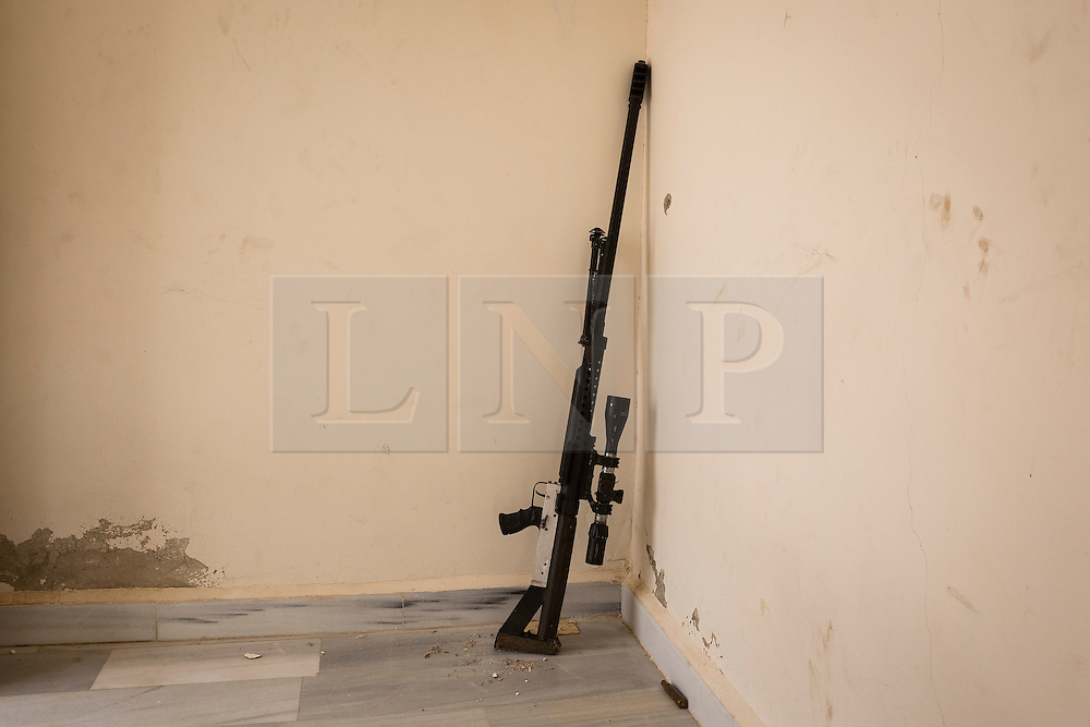 © Licensed to London News Pictures. 28/09/2014. Al-Yarubiyah, Syria. A home made 12.7mm sniper rifle (.50 caliber), fabricated by Syrian-Kurdish YPG fighters, is seen near a firing position in use against ISIS insurgents in Rabia, Syria.<br /> <br /> Facing each other across the Iraq-Syria border, the towns of Al-Yarubiyah, Syria, and Rabia, Iraq, were taken by Islamic State insurgents in August 2014. Since then The town of Al-Yarubiyah and parts of Rabia have been re-taken by fighters from the Syrian Kurdish YPG. At present the situation in the towns is static, but with large exchanges of sniper and heavy machine gun fire as well as mortars and rocket propelled grenades, recently occasional close quarter fighting has taken place as either side tests the defences of the other. Photo credit: Matt Cetti-Roberts/LNP