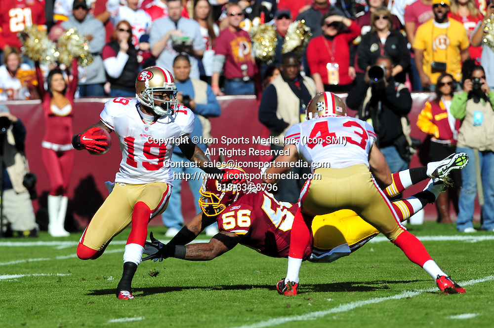 Nov. 06, 2011 - Landover, Maryland, United States of America - NFL game action in Landover Md; San Francisco 49ers wide receiver Ted Ginn (19) escapes Washington Redskins linebacker Perry Riley (56)..The 49ers defeat the Redskins at home 19 -11