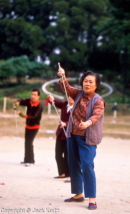 01 DECEMBER 1988 - HONG KONG: People do Tai Chi exercises in Victoria Park in Hong Kong.   PHOTO © JACK KURTZ  women  health  lifestyle