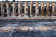 "Standpipes on the top of the Shenango Inc. coke battery collected the gases that are created during coking.The gases are then processed for recovery and sale of benzene, toluene and xylene. Hydrogen sulfide is also collected to meet local emissions regulations.<br /> <br /> At the end of 2015, DTE Energy Corp announced it was closing its Shanango Neville Island plant, located 5 miles downstream on the Ohio River from Pittsburgh, Pa. The facility which produced blast furnace coke and related products for steelmaking, would be shut down due to a ""sharp downtown in the North American steel industry."" <br /> <br /> The Neville Island facility made its final batch of coke on January 6, 2016, ending 54 years of converting coal to metallurgical coke to fuel blast furnaces for steelmaking. The closing left 173 workers unemployed."