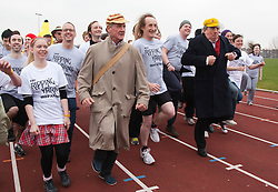 "© Licensed to London News Pictures. 03/03/2012. London, England. L-R: Michael Palin and Terry Jones with race participants. Terry Jones and Michael Palin of Monty Pythons fame today, Saturday 3 March, staged a public ""Hopathon"" to mark the DVD release of Ripping Yarns The Complete Series, and as an homage to the episode entitled Tomkinsons School Days at the Athletics Track in  Hampstead Heath, London. Photo credit: Bettina Strenske/LNP"