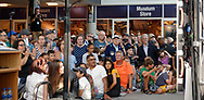 Garden City, New York, U.S. July 20, 2019.  Crowd watches 1969 news coverage of Moon Landing on big screen on stage at the exact time the Apollo 11 Lunar Module, The Eagle, landed on the Moon 50 years ago, at the Apollo at 50 Countdown Celebration at Cradle of Aviation Museum in Long Island. Officials at right include Nassau County Executive LAURA CURRAN, Suffolk County Executive STEVE BELLONE, and NYS Senator KEVIN THOMAS.