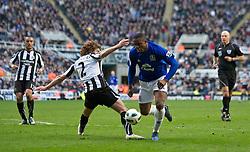 NEWCASTLE, ENGLAND - Saturday, March 5, 2011: Everton's Victor Anichebe and Newcastle United's Fabricio Coloccinni during the Premiership match at St. James' Park. (Photo by David Rawcliffe/Propaganda)
