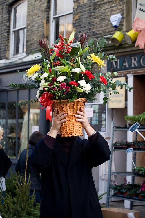 A man walks through the Sunday flower market on London's Columbia Road.