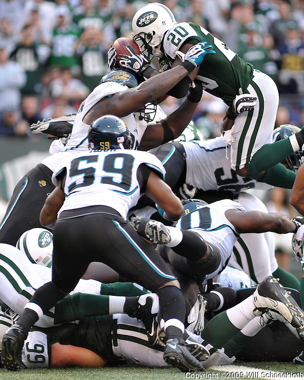 Nov 15, 2009; East Rutherford, NJ, USA; New York Jets running back Thomas Jones (20) dives over the pile for a tochdown during second half NFL action in the Jacksonville Jaguars 24-22 victory over the New York Jets at Giants Stadium.