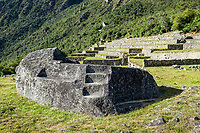 Mortuary rock at Machu Picchu, Incas ruins in the peruvian Andes at Cuzco Peru