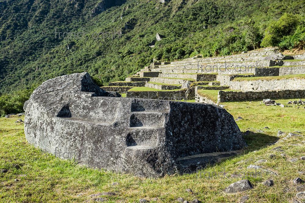 Mortuary rock at Machu Picchu, Incas ruins in the peruvian Andes at Cuzco Peru