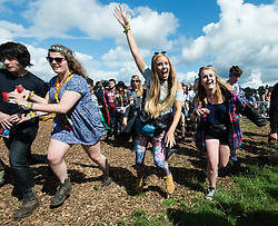 © Licensed to London News Pictures. 28/08/2015. Reading Festival, UK. Festival goers at Reading Festival stream through the gates to the main arena which have just opened for the first time on the morning of Day 1 of the festivalPhoto credit: Richard Isaac/LNP