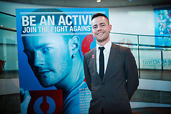 © under license to London News Pictures.  29/11/10 HIV/AIDS sufferer Kristen Johns poses in front of his poster while Boris Johnson unveils the Body Shop 'Be An Activist. Join the Fight Against Aids' exhibition, featuring photography by Rankin to mark World AIDS day at City Hall. Photo credit should read: Olivia Harris/ London News Pictures