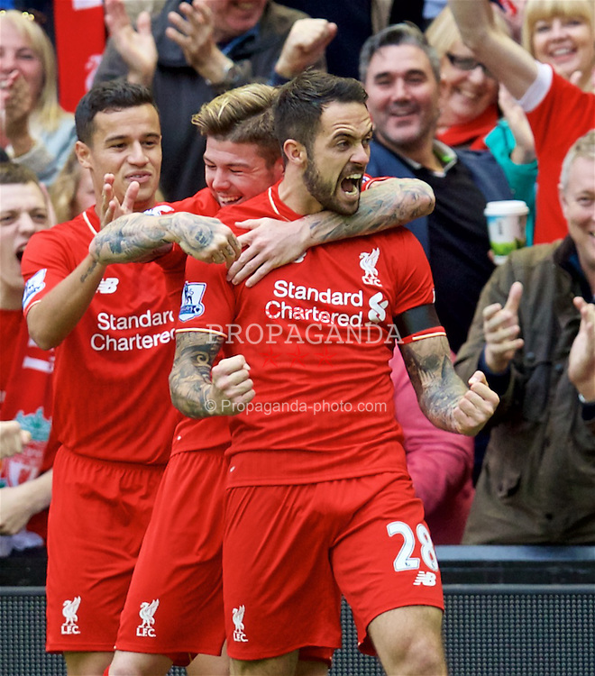 LIVERPOOL, ENGLAND - Sunday, September 20, 2015: Liverpool's Danny Ings celebrates scoring the first goal with team mates Philippe Coutinho Correia and Alberto Moreno during the Premier League match against Norwich City at Anfield. (Pic by David Rawcliffe/Propaganda)