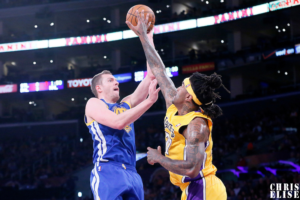 11 April 2014: Golden State Warriors forward David Lee (10) goes for the jump shot over Los Angeles Lakers forward Jordan Hill (27) during the Golden State Warriors 112-95 victory over the Los Angeles Lakers at the Staples Center, Los Angeles, California, USA.
