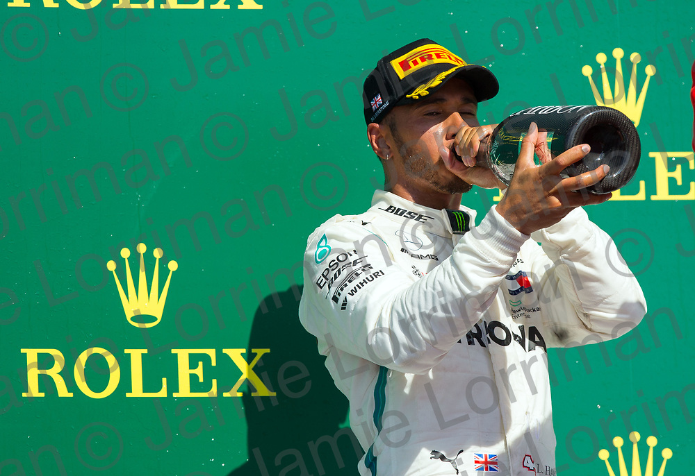 The 2018 Formula 1 F1 Rolex British grand prix, Silverstone, England. Sunday 8th July 2018.<br /> <br /> Pictured: Mercedes AMG Petronas driver Lewis Hamilton celebrates a second place finish at the British Formula 1 Grand Prix at Silverstone.<br /> <br /> Jamie Lorriman<br /> mail@jamielorriman.co.uk<br /> www.jamielorriman.co.uk<br /> 07718 900288