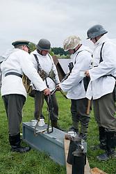 A Re-enactors portrayiing German infantrymen on the Russian Front during a battle battle re-enactment in on Pickering Showground<br /> <br /> 17/18 October 2015<br />  Image © Paul David Drabble <br />  www.pauldaviddrabble.co.uk