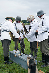 A Re-enactors portrayiing German infantrymen on the Russian Front during a battle battle re-enactment in on Pickering Showground<br /> <br /> 17/18 October 2015<br />  Image © Paul David Drabble <br />  www.pauldaviddrabble.co.uk