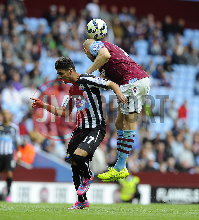 Aston Villa's Phillip Senderos battles for the high ball with Newcastle United's Ayoze Perez - Photo mandatory by-line: Joe Meredith/JMP - Mobile: 07966 386802 23/08/2014 - SPORT - FOOTBALL - Birmingham - Villa Park - Aston Villa v Newcastle United - Barclays Premier League