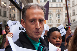 """Mayfair, London, March 19th 2015. Police are called as gay rights campaigners from the Out and Proud Diamond Group, made up of exiled Ugandan and other African gays and their supporters,   demonstrate outside the D&G store in London's Bond Street, following Remarks made by the brand's owners about IVF babies being """"synthetic"""". PICTURED: LGBT and human rights campaigner Peter Tatchell helped to organise the event."""