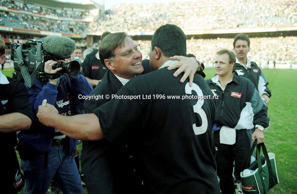 John Hart and Olo Brown hug after the match. Second Test. All Blacks v South Africa, New Zealand Tour of South Africa, 24 October 1996. Photo: Andrew Cornaga/PHOTOSPORT