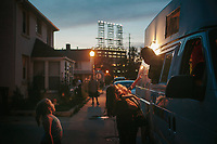 Taylor Collins, 11, lifts her 5-year-old sister Chloie up to an ice cream truck so she can choose her dessert as their sister Gianna, 6, at left, watches. Marktown, an East Chicago neighborhood, is bordered by steel mills and a British Petroleum refinery, seen at back.<br /> <br />     <br /> <br /> American industry disproportionately affects the health of minority and low-income communities, and East Chicago, Ind. &sbquo;&Auml;&icirc; known as the country&sbquo;&Auml;&ocirc;s &sbquo;&Auml;&uacute;most industrialized municipality&sbquo;&Auml;&ugrave; during the Industrial Revolution &sbquo;&Auml;&icirc; offers a view of environmental injustices emerging throughout the Rust Belt.