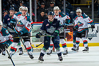 KELOWNA, CANADA - JANUARY 30: Payton Mount #19 of the Seattle Thunderbirds looks for the pass ahead of Nolan Foote #29 and Kaedan Korczak #6 of the Kelowna Rockets  on January 30, 2019 at Prospera Place in Kelowna, British Columbia, Canada.  (Photo by Marissa Baecker/Shoot the Breeze)
