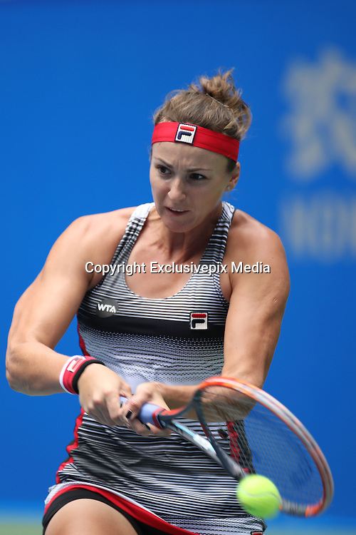 WUHAN, CHINA - SEPTEMBER 28: <br /> <br /> Yaroslava Shvedova of Kazakhstan returns a shot during the women\'s singles third round match against Simona Halep of Romania on day four of the 2016 WTA Dongfeng Motor Wuhan Open at Optics Valley International Tennis Center on September 28, 2016 in Wuhan, China. <br /> &copy;Exclusivepix Media