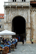 Arch and iron gate, Cathedral of Saint Lawrence (Katedrala sveti Lovre), also called the Cathedral of St. John (sveti Ivan). Trogir, Croatia