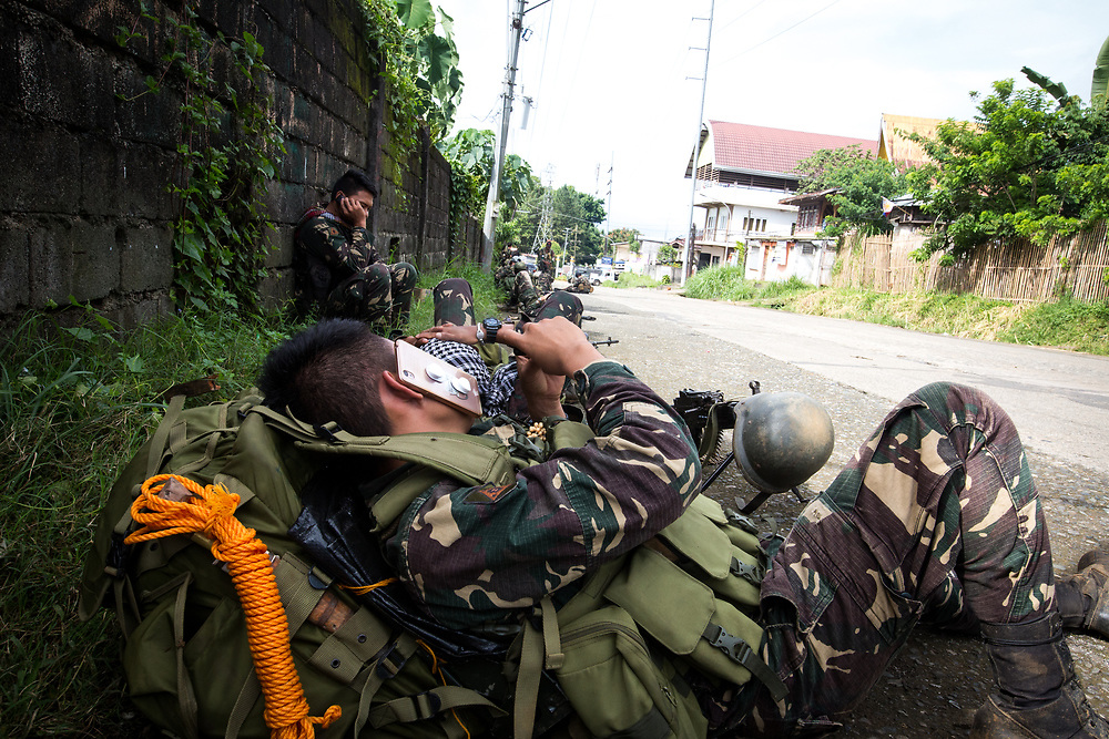 MARAWI, PHILIPPINES - JUNE 6: Government troops uses their mobile phones to contact their love ones before going to fight with Islamist rebel in Marawi City, Southern Philippines, June 6, 2017. (Photo: Richard Atrero de Guzman/NUR Photo)