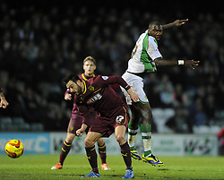 Yeovil Town's Ishmael Miller battles for the high ball with Watford's Marco Cassetti - Photo mandatory by-line: Joe Meredith/JMP - Tel: Mobile: 07966 386802 18/02/2014 - SPORT - FOOTBALL - Yeovil - Huish Park - Yeovil Town v Watford - Sky Bet Championship