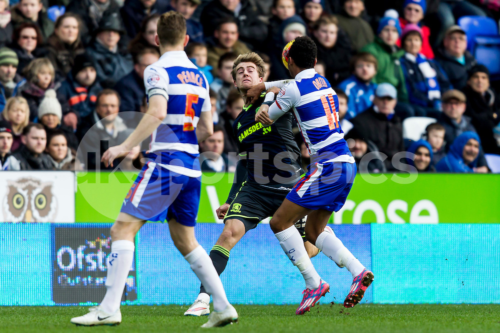 Patrick Bamford of Middlesbrough comes under pressure from Jordan Obita of Reading during the Sky Bet Championship match between Reading and Middlesbrough at the Madejski Stadium, Reading, England on 10 January 2015. Photo by Gareth  Brown.
