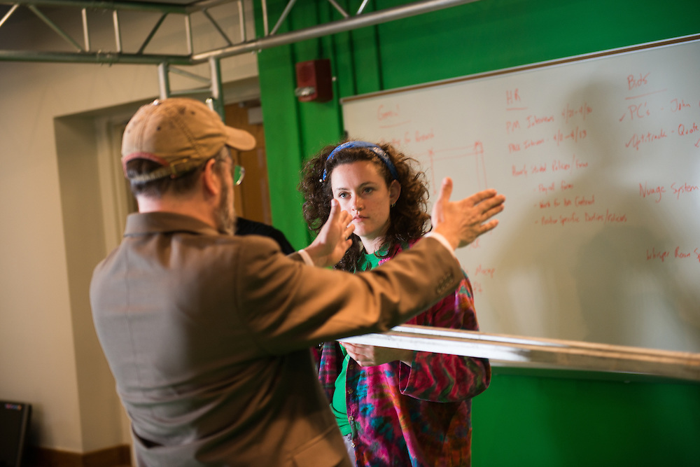 Abbie Doyle lsitens to Eric Williams, GRID Lab. © Ohio University / Photo by Ben Siegel