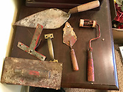 Some of Preachers tools- trovel, concrete tools, and small paint roller and t-square from red door- used as a lock!<br />