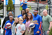 The Harlem Globetrotters pose for photos with people visiting the SkyView Atlanta ferris wheel during a downtown tour and basketball demonstration in between shows scheduled for Saturday, March 14, at the Arena at Gwinnett, during a rare day off, Monday, March 9, 2015, in Atlanta. David Tulis / AJC Special
