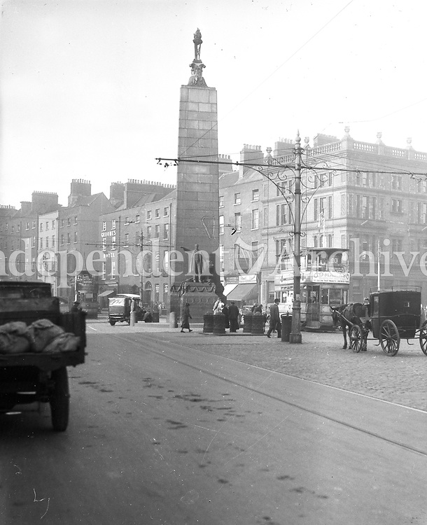 View of O'Connell St Dublin showing the Charles Stewart Parnell Monument, installed by Augustus Saint Gaudens in 1910/1911. (Part of the Independent Newspapers Ireland/NLI Collection)