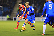 Josh Wright under pressure from Matty Lund during the EFL Sky Bet League 1 match between Gillingham and Rochdale at the MEMS Priestfield Stadium, Gillingham, England on 26 November 2016. Photo by Daniel Youngs.