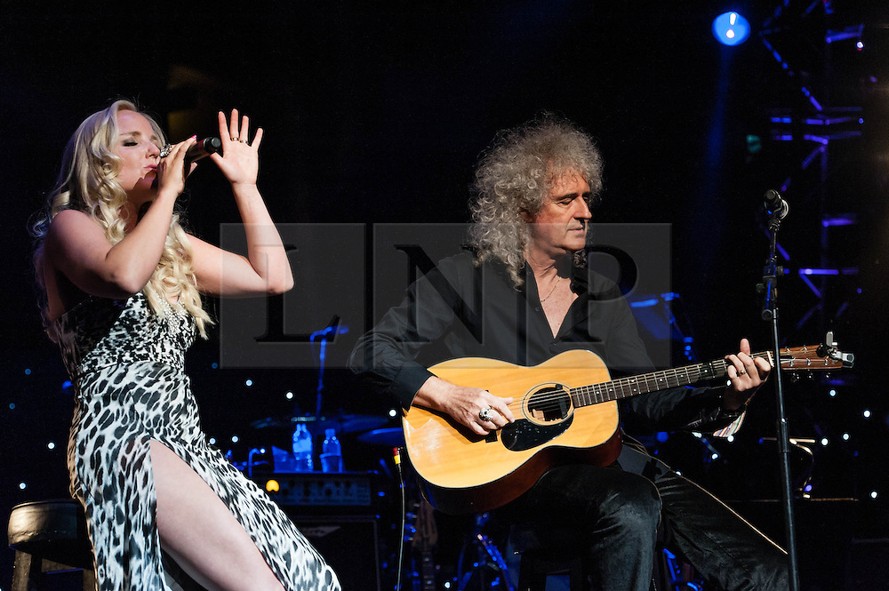 "© Licensed to London News Pictures. 16/09/2012. London, UK.  Kerry Ellis (L) and Brian May (Right)  perform at The Sunflower Jam at the Royal Albert Hall.  The Sunflower Jam is a British charity, founded by Jacky Paice, wife of Deep Purple drummer, Ian Paice. Other high-profile supporters are the actor Jeremy Irons, ex-Jamiroquai bassist Nick Fyffe and Charles, Prince of Wales. The aims of the charity are to fund complementary therapists and spiritual healers to work on cancer wards in the British National Health Service. After setting up a meeting between members of Deep Purple and a young boy dying of leukemia, Paice saw ""all the good work the healers were doing"" and decided ""lets find a way to raise money to get more healers in there. Brian May is a founding member and guitarist of Queen, Kerry Ellis is a lead singer in West End Musicals and played the role of 'Meat' in Queen's We Will Rock You  Photo credit : Richard Isaac/LNP"