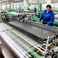 """This Carpet factory in Sheki Town in Azerbaijan is run mostly by the towns women. Looking at there wardrobe I finally see were the term """"Blue Collar Worker"""" comes from."""