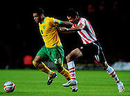 Southampton - Tuesday, September 30th, 2008: Andrew Surman of Southampton and Darel Russell of Norwich City during the Coca Cola Championship match at Southampton. (Pic by Daniel Hambury/Focus Images)