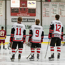 GEORGETOWN, ON - DECEMBER 5: Bailey Molella #11, Jordan Crocker #9, and Matt McJannet #12 of the Georgetown Raiders stand for the national anthem December 5, 2018 at Gordon Alcott Memorial Arena in Georgetown, Ontario, Canada.<br /> (Photo by Dave Fryer / OJHL Images)