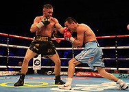 Ryan Burnett (left) in action against Zhanat Zhakiyanov in action during their IBF and WBA Super World Bantamweight Championship bout at the SSE Arena, Belfast.