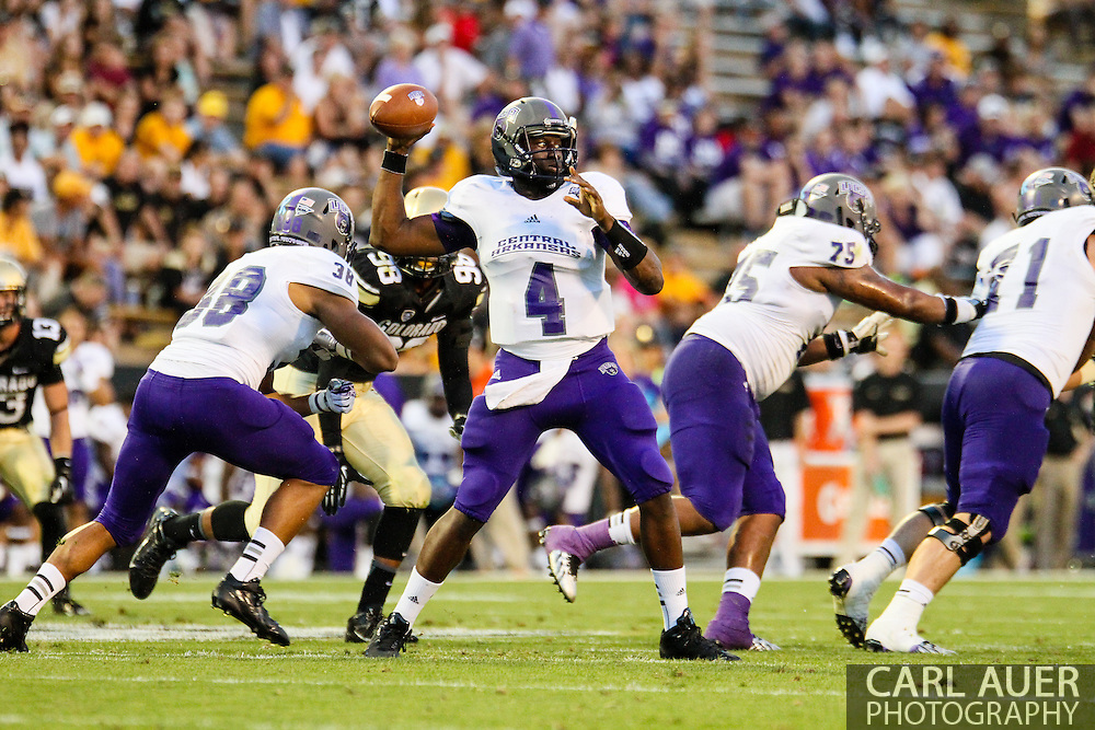 September 7th, 2013 - University of Central Arkansas Bears senior quarterback Wynrick Smothers (4) looks to pass in the second quarter of the NCAA football game between the University of Central Arkansas Bears and the University of Colorado Buffaloes at Folsom Field in Boulder, CO