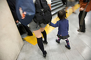 young fashionable dressed mother walking with child Tokyo Japan
