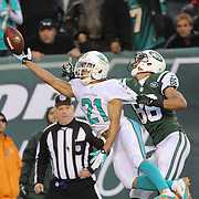 Brent Grimes, Miami Dolphins, just fails to make a catch while challenged by David Nelson, New York Jets, during the New York Jets Vs Miami Dolphins  NFL American Football game at MetLife Stadium, East Rutherford, NJ, USA. 1st December 2013. Photo Tim Clayton