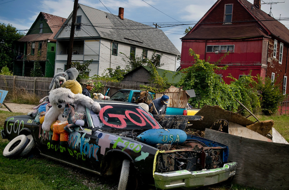 Scrap metal collectors loading their truck with metal nearby the Heidelberg Project - a transformation of a devastated East Detroit neigborhood .into an art park by artist TyreeGuyton...Photographer: Chris Maluszynski /MOMENT